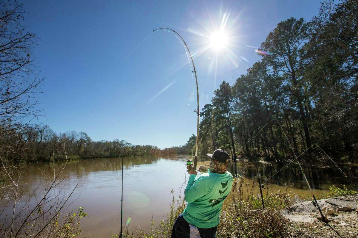 Derrick Taylork, of Huntsville, fishes in Stubblefield Lake in Sam Houston National Forest on Friday, Jan. 4, 2019, in New Waverly. The Trump administration is seeking to open more than 1.9 million acres of national forests and grasslands in Texas to more oil and natural gas drilling activity.