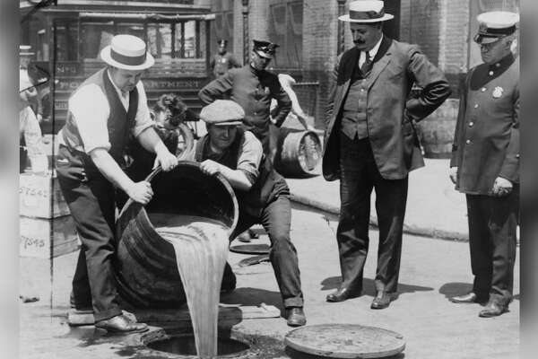 1922 Answer: Prohibition Reporting from the Cato Institute suggests alcohol consumption began to rise in 1922 after a period of decline. Prohibition was in effect from 1920 to 1933, during which time the black market and mob activity spiked-not to mention tax dollars toward enforcing the law. Federal agents were tasked with enforcement, which meant regular Prohibition raids at speakeasies, restaurants, coffee houses, saloons, vehicles, and private property. New Orleans alone saw thousands of raids throughout Prohibition. [Pictured: New York City Deputy Police Commissioner John A. Leach, right, watching agents pour liquor into sewer following a raid during the height of prohibition.] This slideshow was first published on theStacker.com