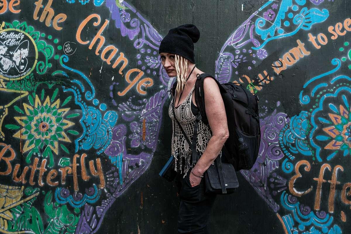 Shauna Artiago pauses on the corner of Eddy and Golden Gate in the Tenderloin in San Francisco, Calif. on Thursday, November 21, 2019.