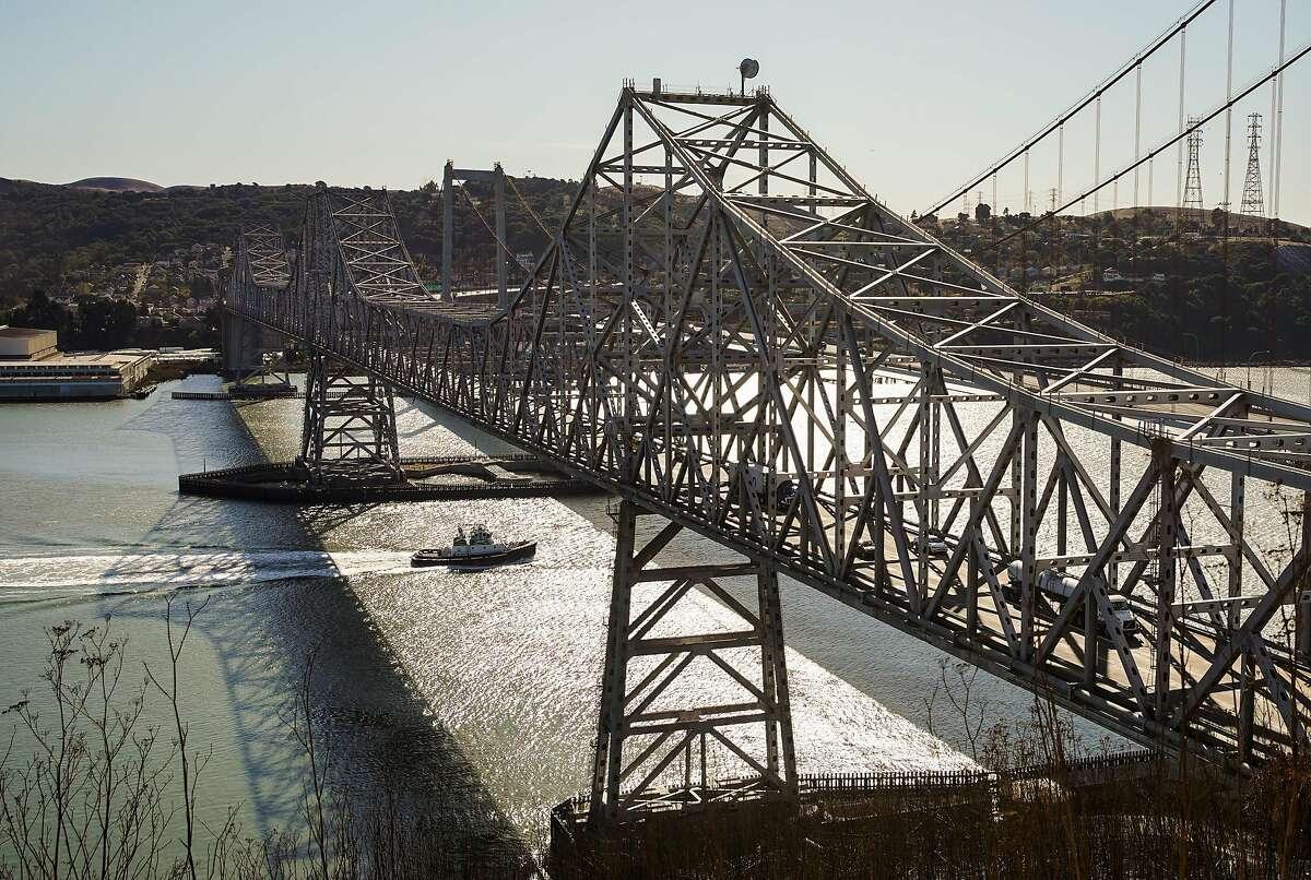 A tugboat passes under the Carquinez Bridge on Monday, November 25, 2019, in Vallejo, California.