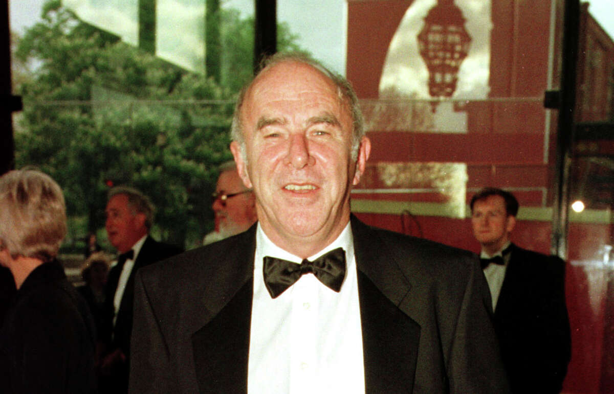 FILE - In this April 24, 1997 file photo, Clive James arrives at the Royal Albert Hall for the BAFTA award ceremony. James, an Australian journalist, joker and intellectual who had a long career as a writer and broadcaster, has died. He was 80. Jamesa€™ representatives, United Agents, said he died Sunday at his home in Cambridge, and a private funeral was held Wednesday, Nov. 27, 2019. (Fiona Hanson/PA via AP, File)