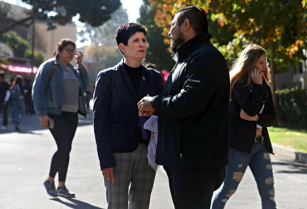 New San Francisco State University president Lynn Mahoney (left) takes a walk on campus with administrative support Luis De Paz Fernandez (right) on Monday, Nov. 4, 2019, in San Francisco, Calif.