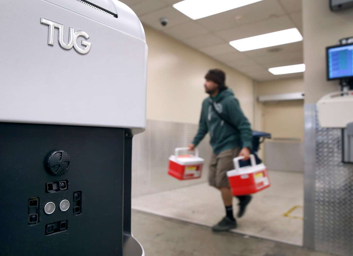 Proximity sensors and cameras mounted on the front of a Tug autonomous mobile robot helps the device avoid obstacles while transporting supplies at the Stanford Medical Center in Stanford, Calif. on Tuesday, Nov. 26, 2019. Twenty-three of the robots will be joining a fleet of five already in service to deliver supplies and linen throughout the sprawling hospital.