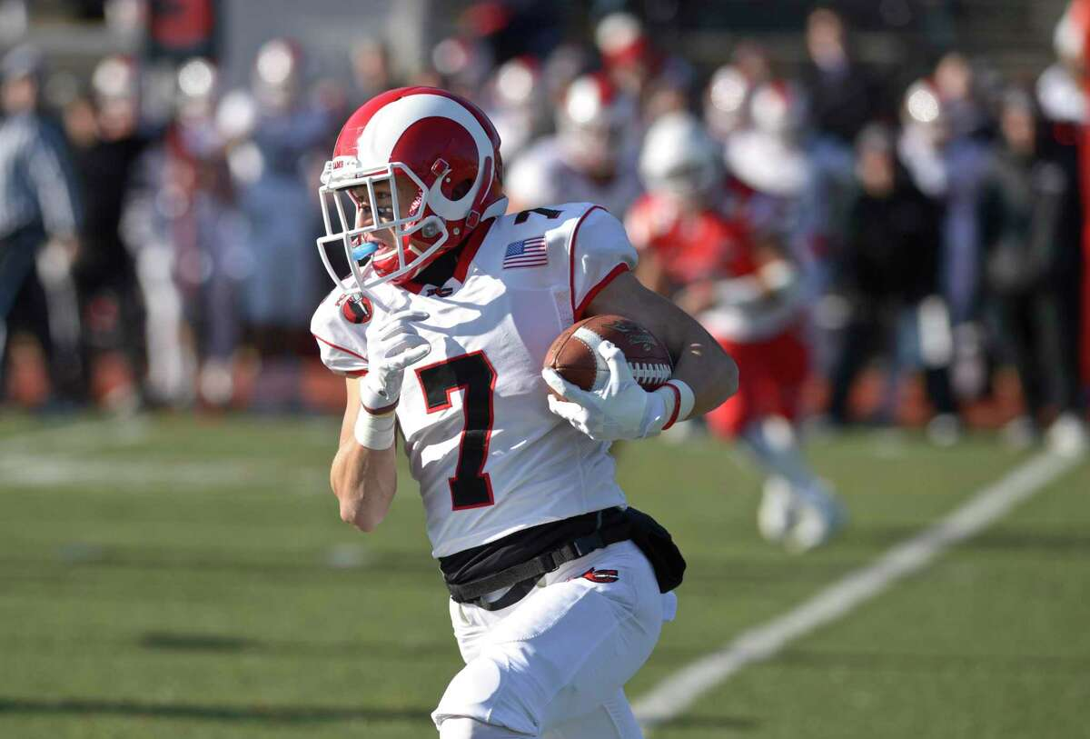 New Canaan's Zach LaPolice (7) takes a pass reception around the corner in the Connecticut high school Class LL football championship game between Greenwich and New Canaan high schools, Saturday morning, December 8, 2018, at Boyle Stadium, Stamford High School, Stamford, Conn.