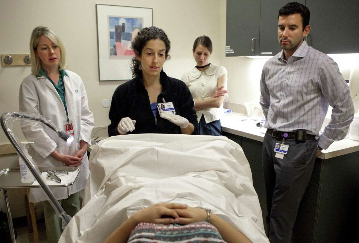 Then-first year medical resident Naomi Shike consults with a model during a pelvic-exam training session in 2013 in Seattle, Wash. In Texas and in most other states it is legal for medical students to perform medically unnecessary pelvic exams on women who are unconscious and who did not give meaningful consent for the exam beforehand.