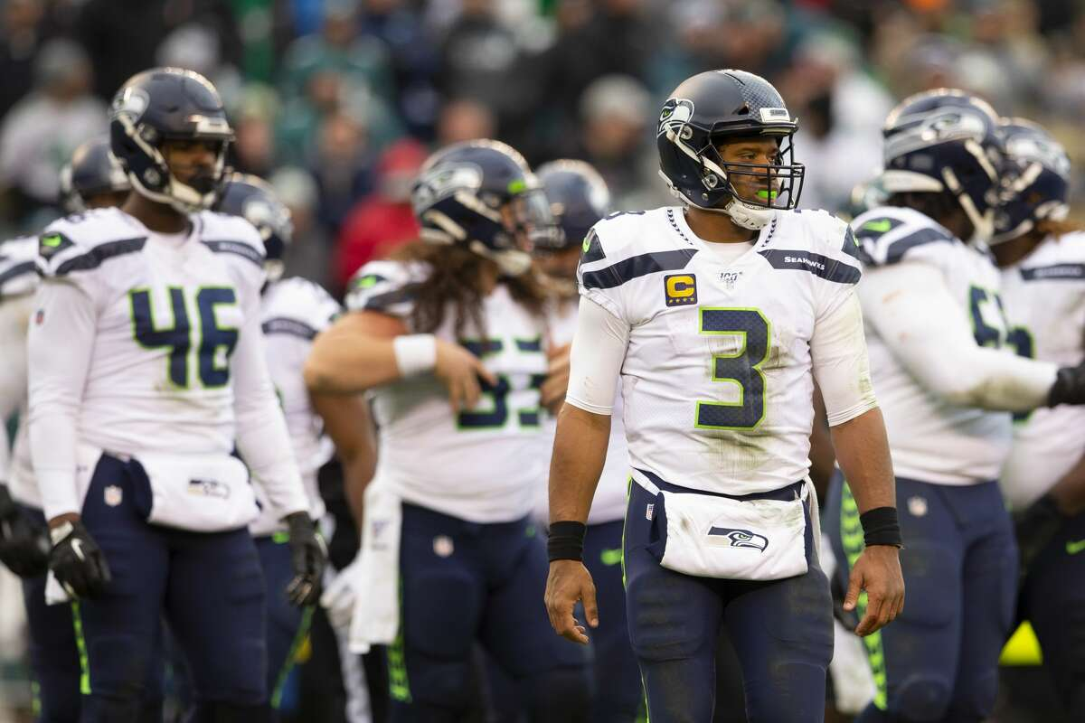 PHILADELPHIA, PA - NOVEMBER 24: Russell Wilson #3, Tyrone Swoopes #46, and Joey Hunt #53 of the Seattle Seahawks look on against the Philadelphia Eagles at Lincoln Financial Field on November 24, 2019 in Philadelphia, Pennsylvania. (Photo by Mitchell Leff/Getty Images)