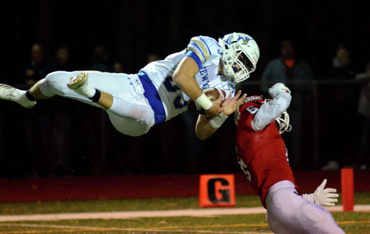 Newtown's Jared Dunn (33) catches a pass against Masuk on Wednesday in Monroe. For game story and photos visit gametimect.com.