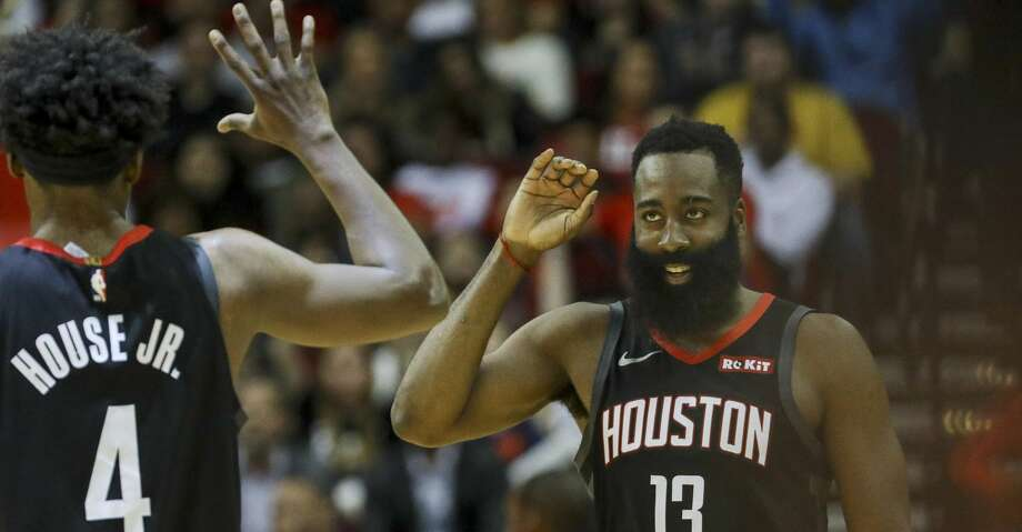 Houston Rockets guard James Harden (13) celebrates with forward Danuel House Jr. (4) during the second quarter of an NBA basketball game at the Toyota Center on Wednesday, Nov. 27, 2019, in Houston. Photo: Jon Shapley/Staff Photographer