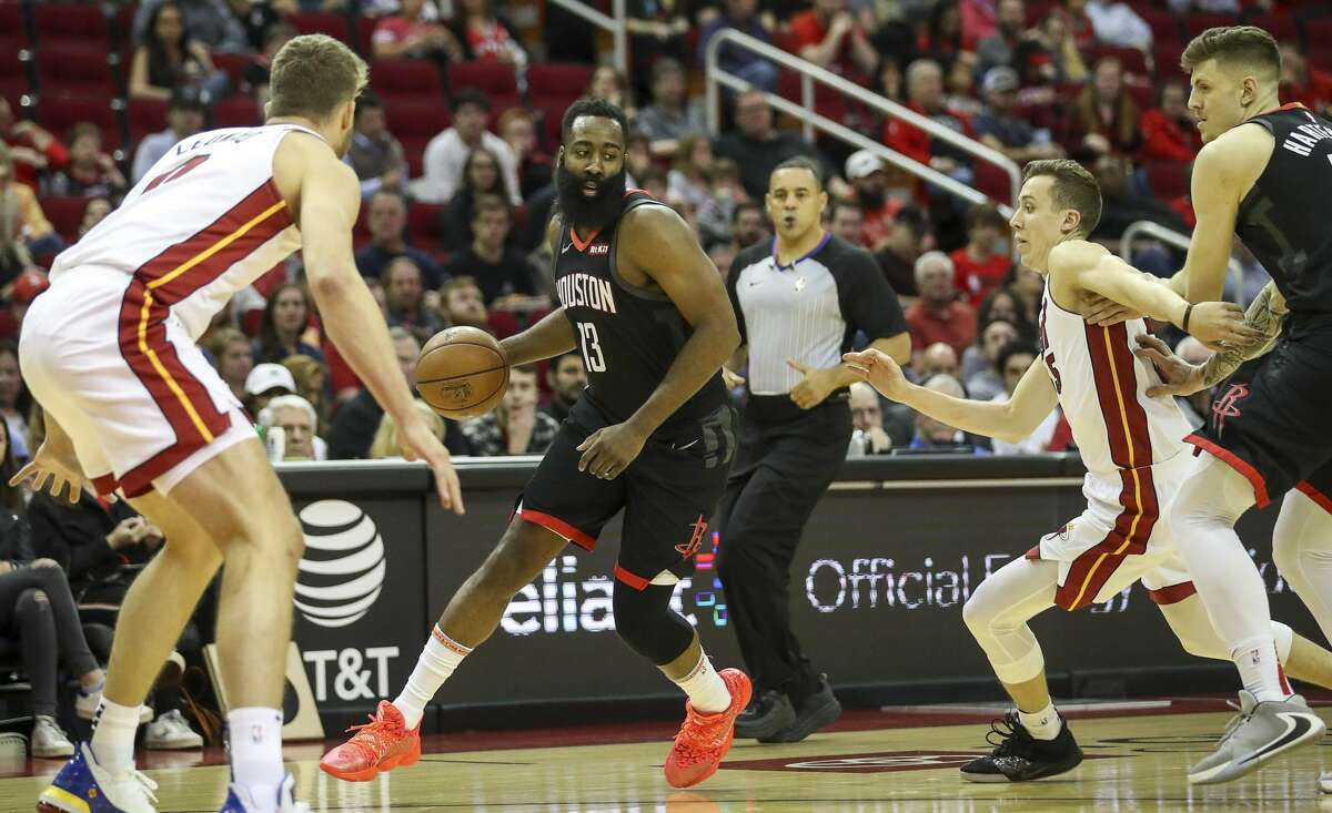 Houston Rockets guard James Harden (13) moves the ball downcourt during the first quarter of an NBA basketball game at the Toyota Center on Wednesday, Nov. 27, 2019, in Houston.