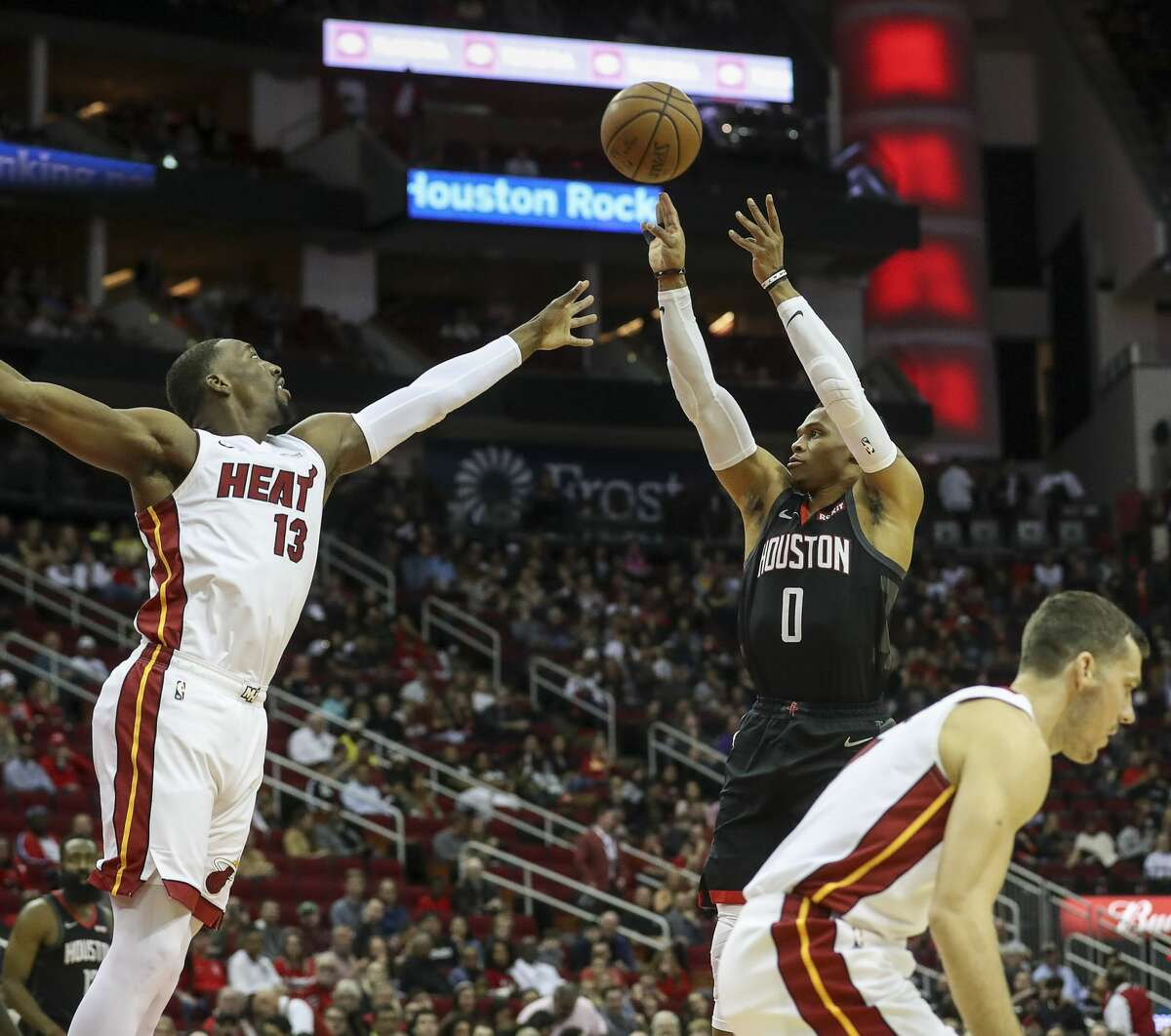 Houston Rockets guard Russell Westbrook (0) shoots over Miami Heat center Bam Adebayo (13) during the first quarter of an NBA basketball game at the Toyota Center on Wednesday, Nov. 27, 2019, in Houston.