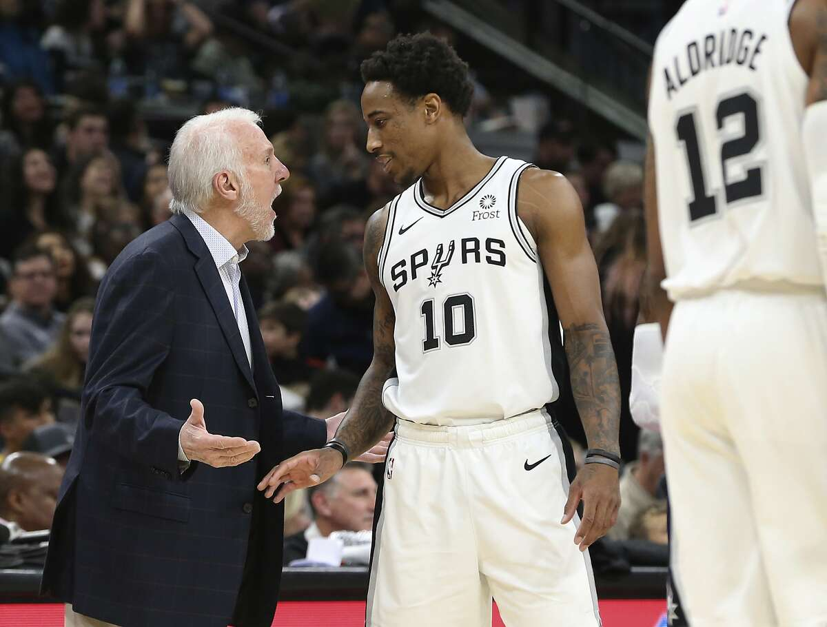 Spurs' head coach Gregg Popovich (left) and DeMar DeRozan (10) talk during a pause in the game against the Minnesota Timberwolves during their game at the AT&T Center on Wednesday, Nov. 27, 2019.