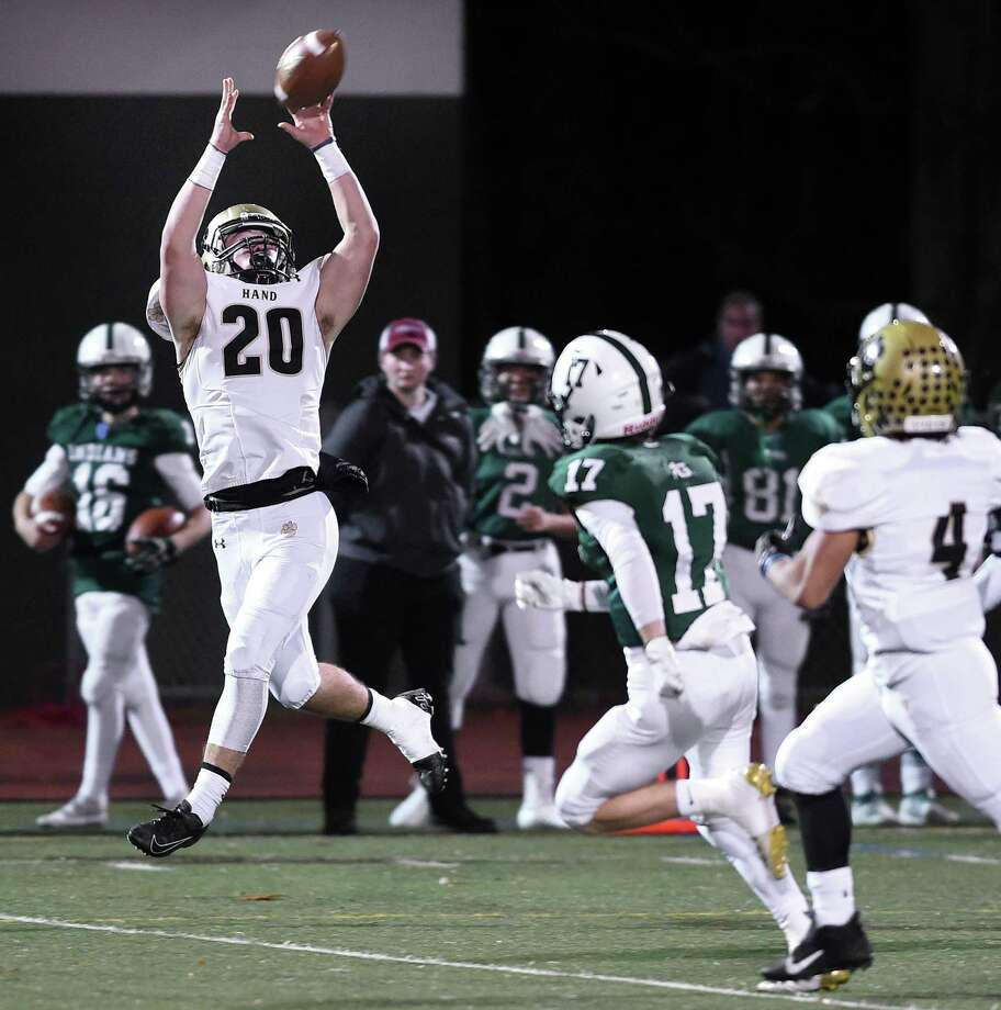 Colin McCabe of Daniel Hand catches a pass and runs for a 65 yard touchdown against Guilford to go up 6-0 in the first quarter on November 27, 2019. Photo: Arnold Gold / Hearst Connecticut Media / New Haven Register