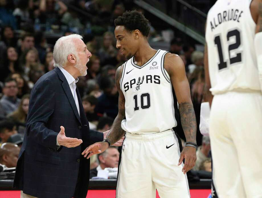 Spurs' head coach Gregg Popovich (left) and DeMar DeRozan (10) talk during a pause in the game against the Minnesota Timberwolves during their game at the AT&T Center on Wednesday, Nov. 27, 2019. Photo: Kin Man Hui, San Antonio Express-News / Staff Photographer / **MANDATORY CREDIT FOR PHOTOGRAPHER AND SAN ANTONIO EXPRESS-NEWS/NO SALES/MAGS OUT/ TV OUT