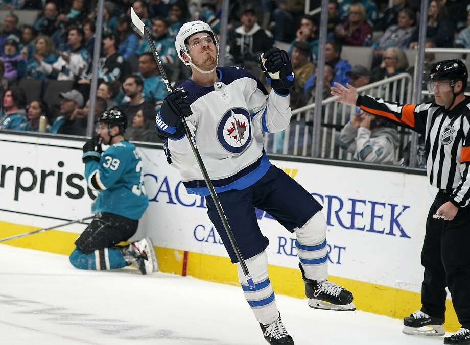 Jets center Jack Roslovic celebrates after scoring in the second period at SAP Center on Wednesday. Winnipeg scored five goals while ending the Sharks' three-game winning streak. Photo: Tony Avelar / Associated Press