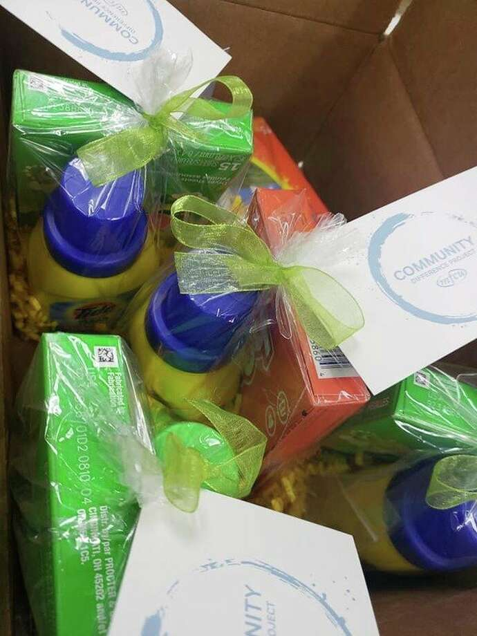 Credit union staffers handed out laundry kits, among other things, on World Kindness Day. (Photo provided)
