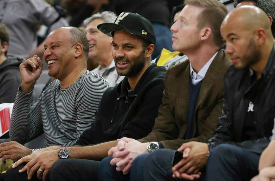 Former Spur Tony Parker (center) attends the Spurs game against the Minnesota Timberwolves at the AT&T Center on Wednesday, Nov. 27, 2019. Photo: Kin Man Hui, San Antonio Express-News / Staff Photographer / **MANDATORY CREDIT FOR PHOTOGRAPHER AND SAN ANTONIO EXPRESS-NEWS/NO SALES/MAGS OUT/ TV OUT