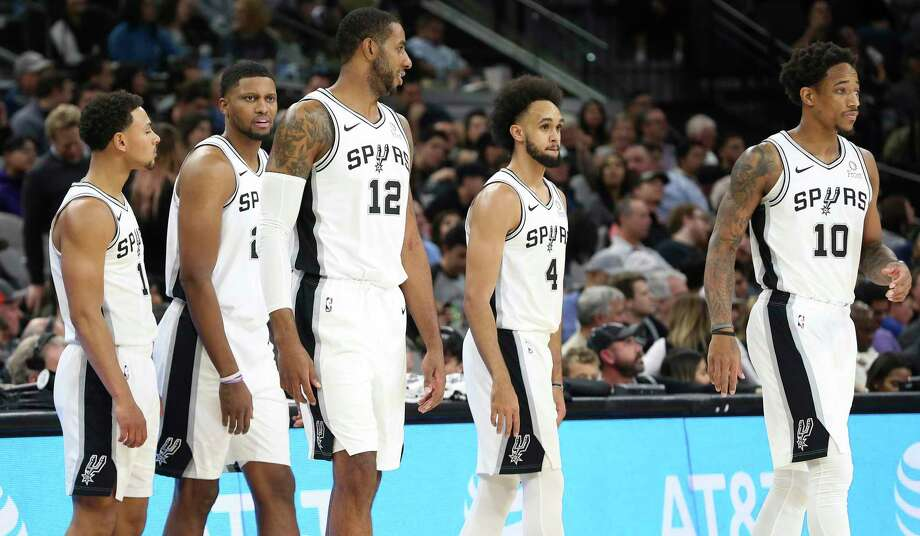 Spurs players Bryn Forbes (11), Rudy Gay (22), LaMarcus Aldridge (12), Derrick White (04) and DeMar DeRozan (10) take the floor against the Minnesota Timberwolves during their game at the AT&T Center on Wednesday, Nov. 27, 2019. Photo: Kin Man Hui, San Antonio Express-News / Staff Photographer / **MANDATORY CREDIT FOR PHOTOGRAPHER AND SAN ANTONIO EXPRESS-NEWS/NO SALES/MAGS OUT/ TV OUT