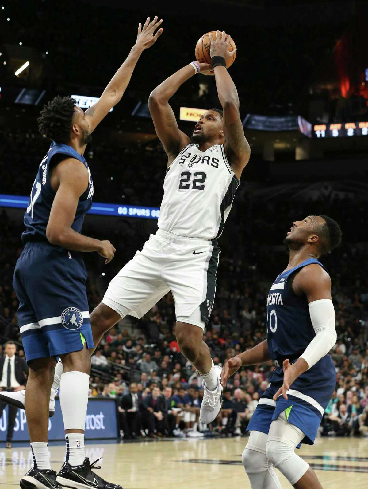 Spurs' Rudy Gay (22) shoots against Minnesota Timberwolves' Keita Bates-Diop (31) and Jeff Teague (00) during their game at the AT&T Center on Wednesday, Nov. 27, 2019.