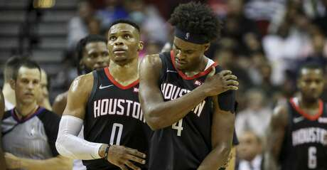 Houston Rockets guard Russell Westbrook (0) gets forward Danuel House Jr. (4) away from a scuffle during the fourth quarter of an NBA basketball game at the Toyota Center on Wednesday, Nov. 27, 2019, in Houston.