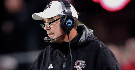 Texas A&M head coach Jimbo Fisher looks on from the sideline in the second half of an NCAA college football game against Georgia, Saturday, Nov. 23, 2019, in Athens, Ga. Georgia won 19-13. (AP Photo/John Bazemore)