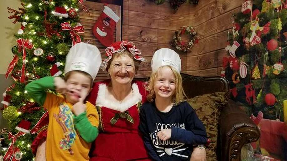 Elf School students Jack Gajewski, 4, and his sister, Violet, 6, pause for a photo with Mrs. Claus during last year's Downtown Country Christmas Festival in Jerseyville. This year's event is planned Saturday.