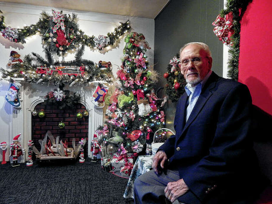 Tom Winner of Heart of Jacksonville tries out Santa's chair on Tuesday while making sure Santa's house on the south side of the downtown Jacksonville square is ready for the jolly one's arrival Friday. Photo: Angela Bauer   Journal-Courier