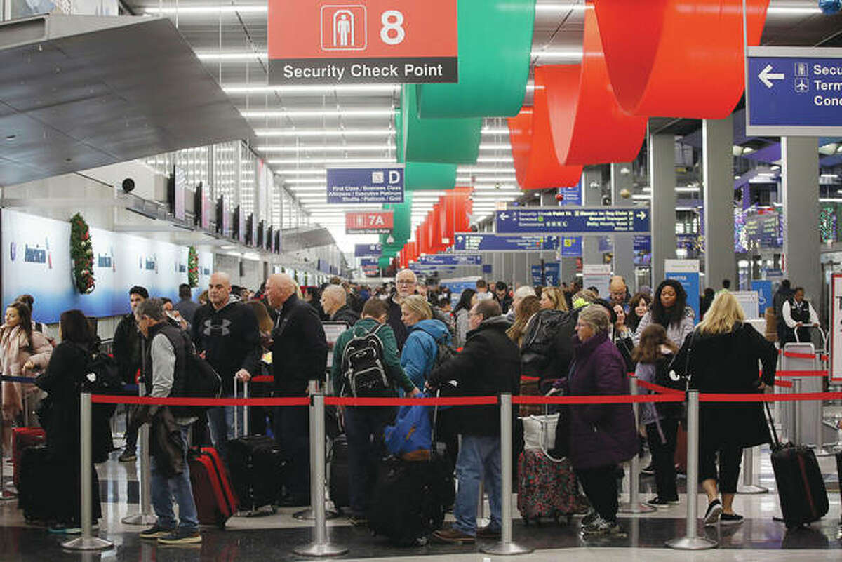 Passengers wait Wednesday in a security line at the American Airlines terminal at O'Hare International Airport in Chicago.