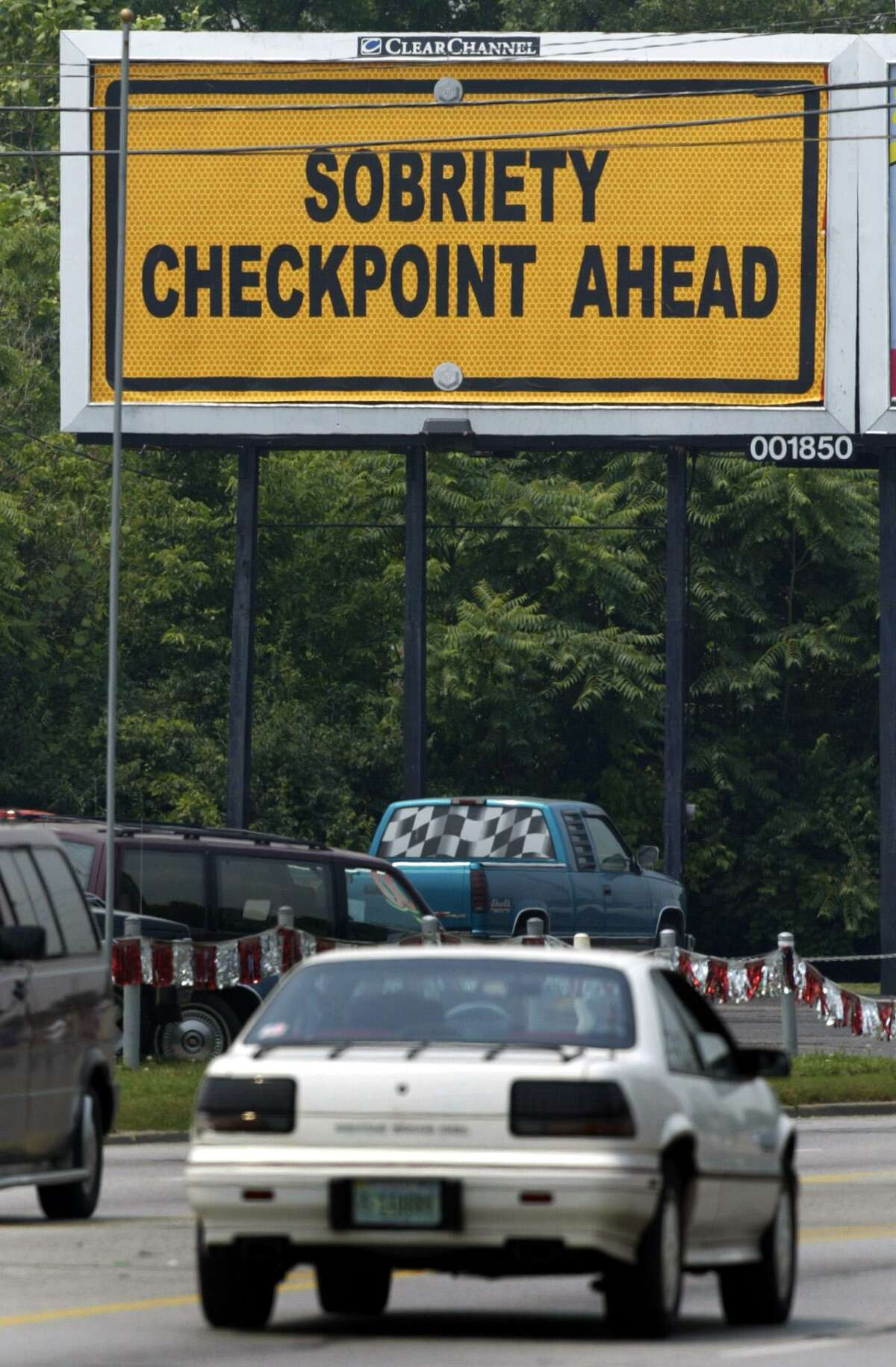 ** FILE ** A motorist approaches a billboard reading