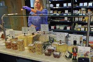 A customer asks to sample some of the cheeses for sale at Spread Cheese Co. in the market at 386 Main St., Middletown. Middletown Mayor Ben Florsheim, Lt. Gov. Susan Bysiewicz and others spoke Wednesday at Main Street Market to encourage people to frequent local establishments on Small Business Saturday.