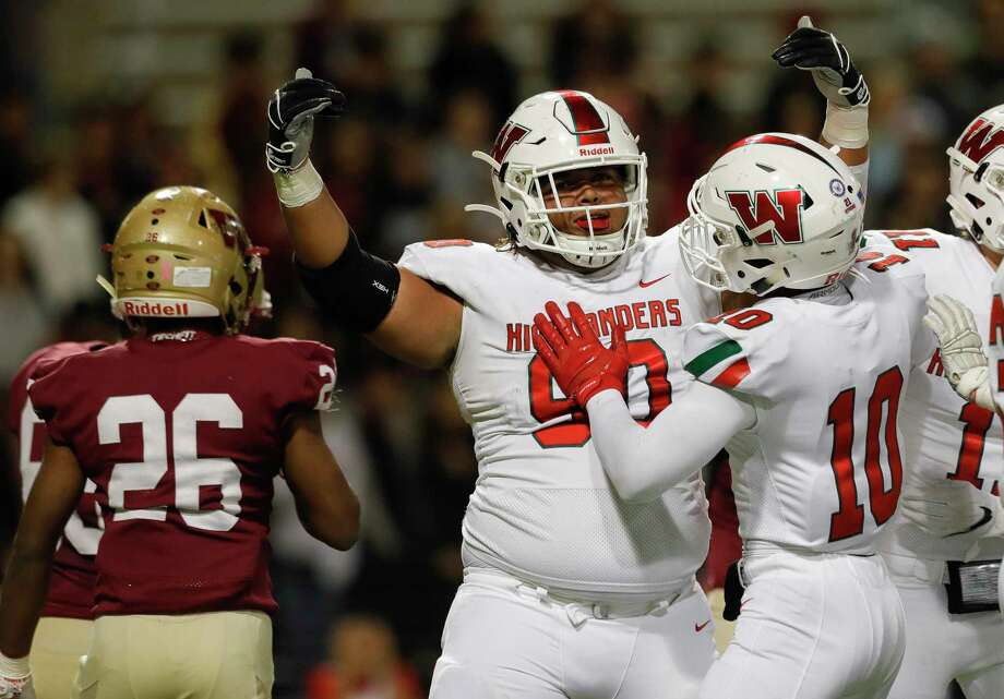 The Woodlands defensive linemen Caleb Fox (90) reacts after sacking Cypress Woods quarterback Jackson Jones (9) during the first quarter of a Region II-6A area high school football playoff game at Cy-Fair FCU Stadium, Friday, Nov. 22, 2019, in Cypress. Photo: Jason Fochtman, Houston Chronicle / Staff Photographer / Houston Chronicle