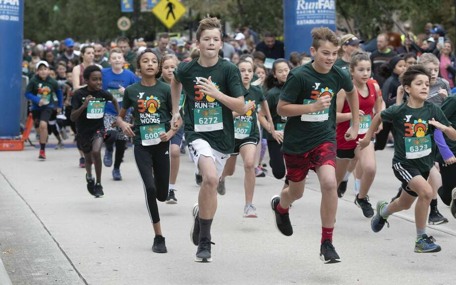 More than 5,200 runners took part in the annual Run Thru the Woods, Thursday, Nov. 28, 2019, in The Woodlands. Photo: Jason Fochtman/Staff Photographer