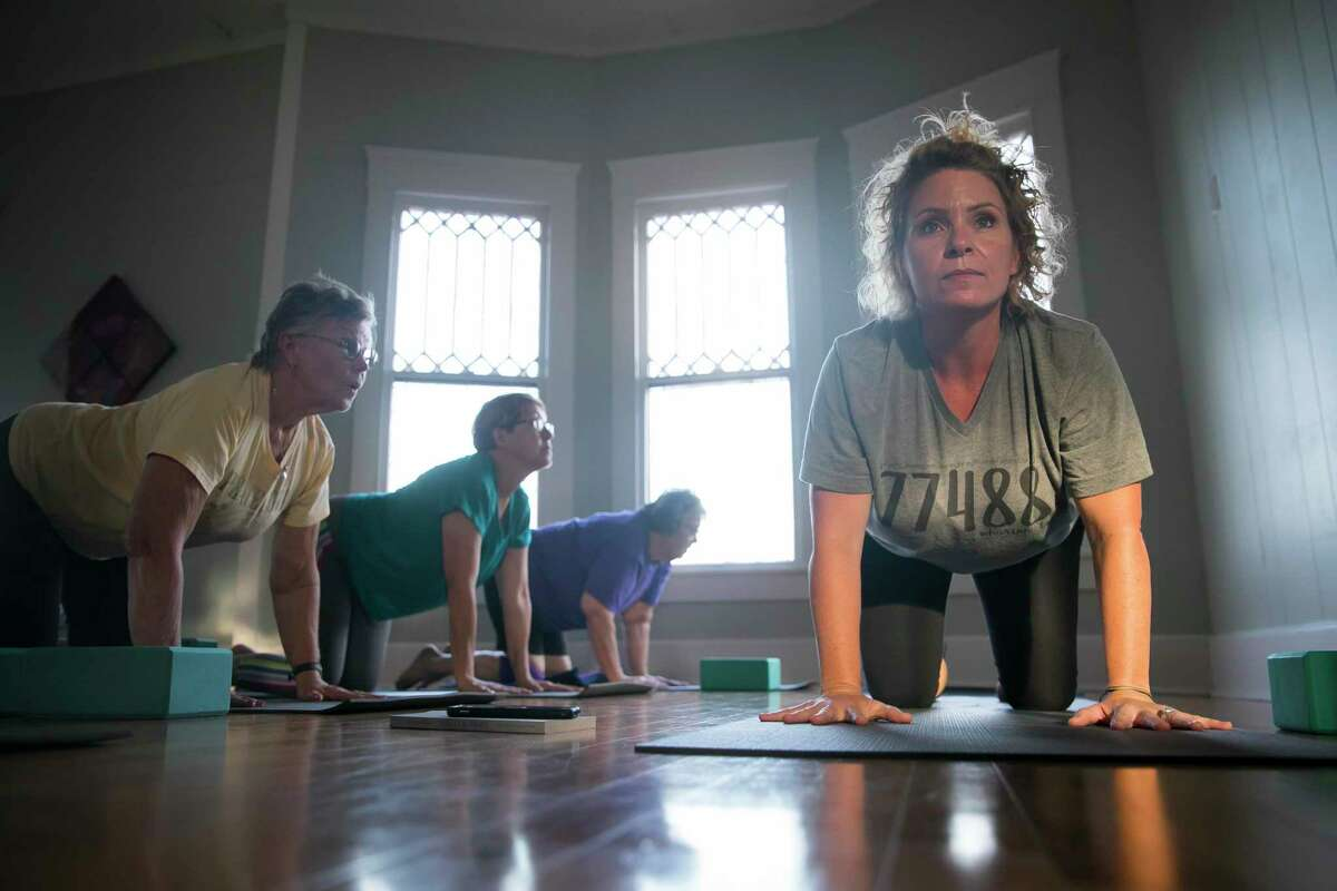 Stephanie Konvicka leads during a yoga class on Sept. 3, 2019, at Hesed House in Wharton.