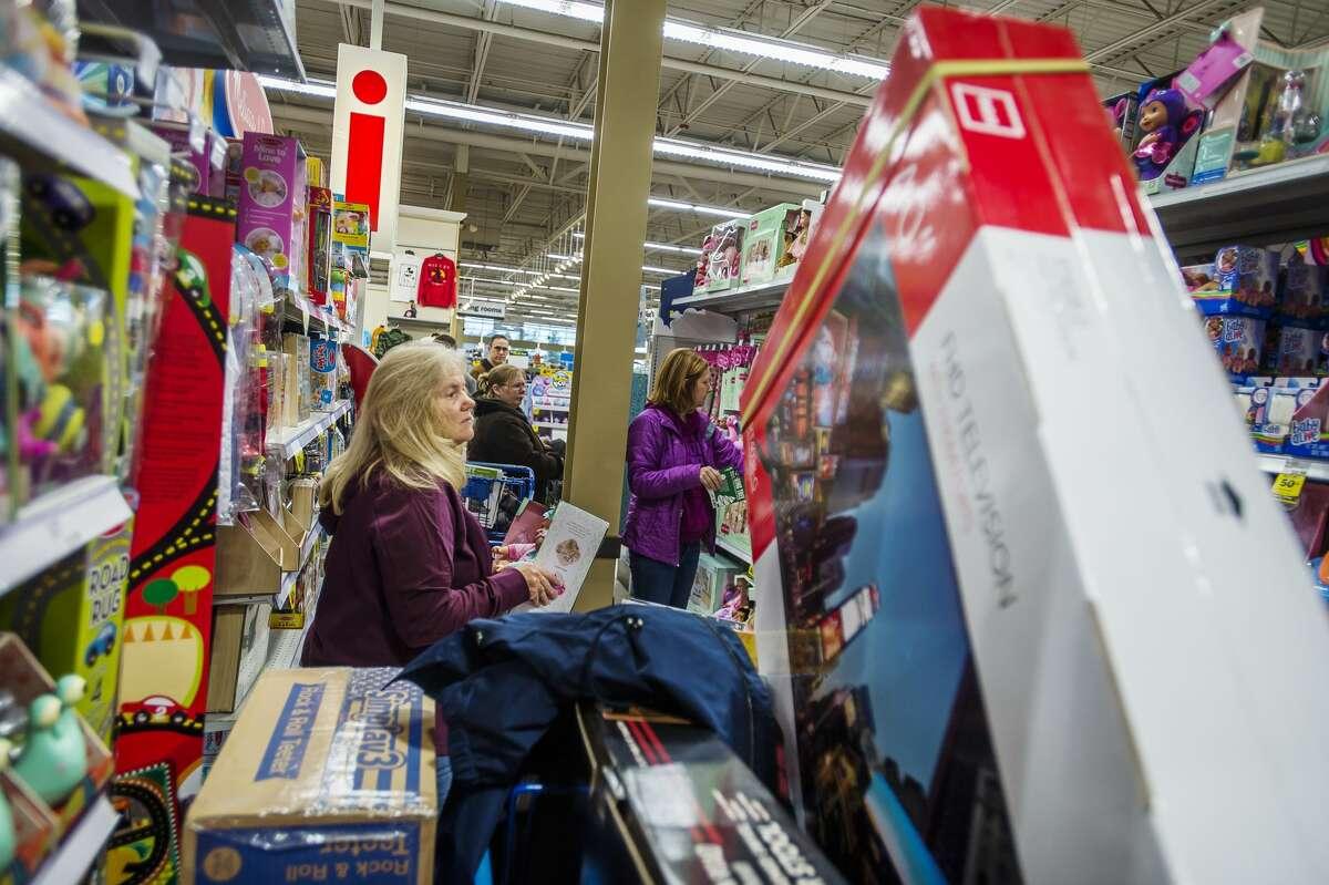 Karren Elledge shops for presents for her family as shoppers take advantage of Black Friday deals at Meijer, which began on Thanksgiving morning, Thursday, Nov. 28, 2019. (Katy Kildee/kkildee@mdn.net)