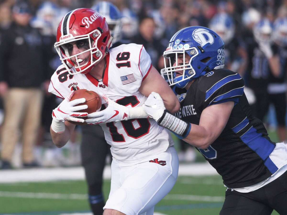 New Canaan's Christian Sweeney (16) heads to the end zone as Darien's Sam Wilson (9) attempts to bring him down during the annual Turkey Bowl football game at Darien High School on Thursday, Nov. 28, 2019.