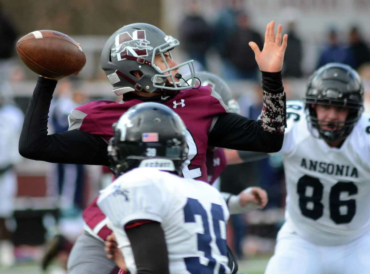 Naugatuck QB John Mezzo looks to throw a pass during Thanksgiving Day football action against Ansonia in Naugatuck, Conn., on Thursday Nov. 28, 2019.