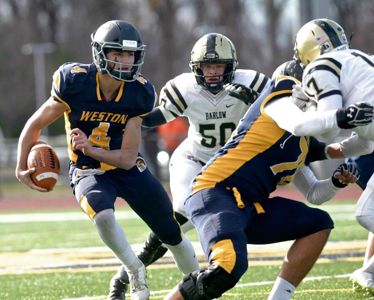 Weston quarterback James Goetz runs with the ball against Barlow on Thanksgiving.