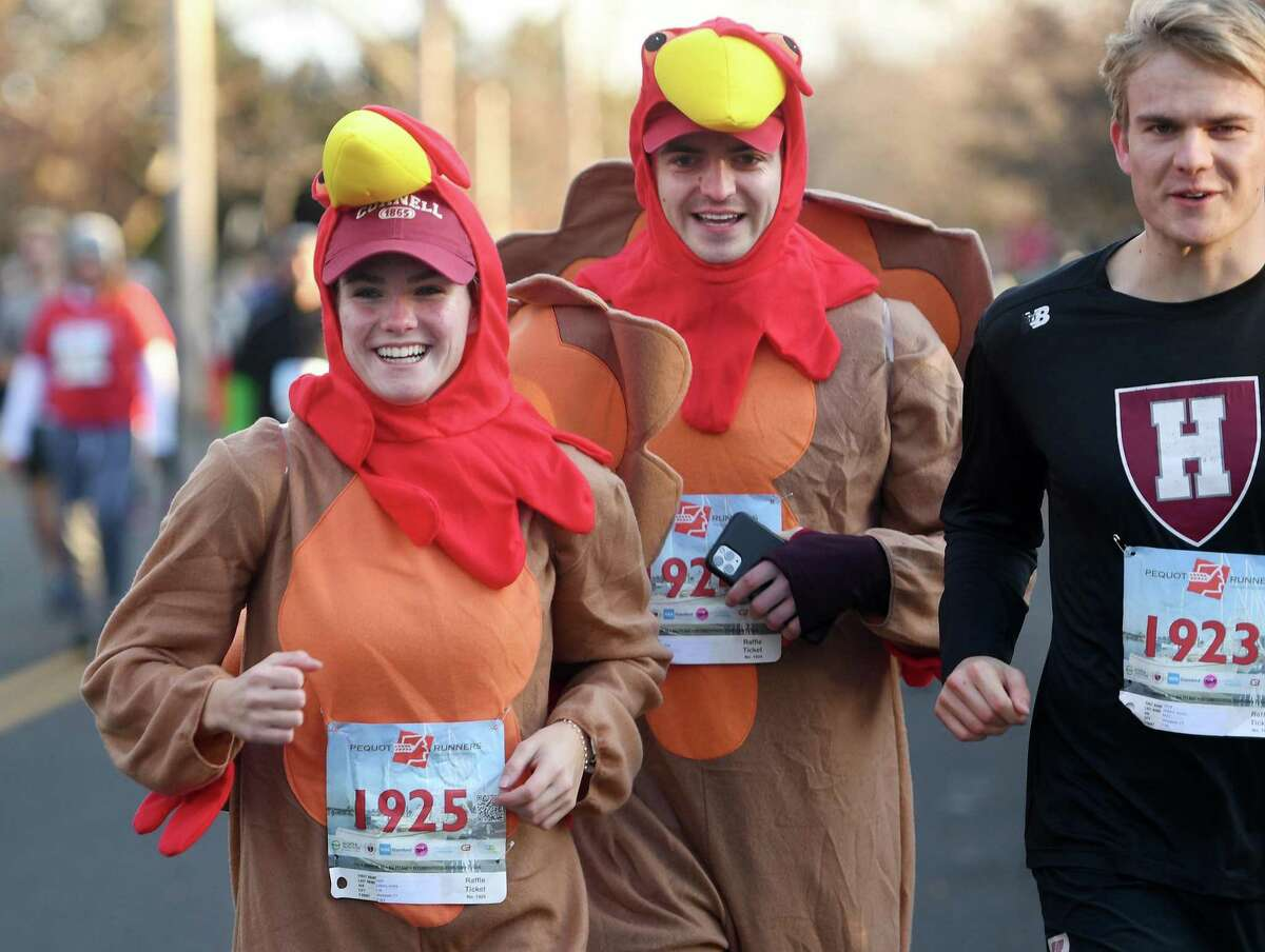 From left; Greta Gilbert, of Westport, Fritz Bacon, of New York City, and Austin Gilbert, of Westport, are dressed for the occasion at the 42nd Annual Pequot Runners Thanksgiving Day 5 Mile Road Race, in Southport, Conn. on Thursday, November 28, 2019.