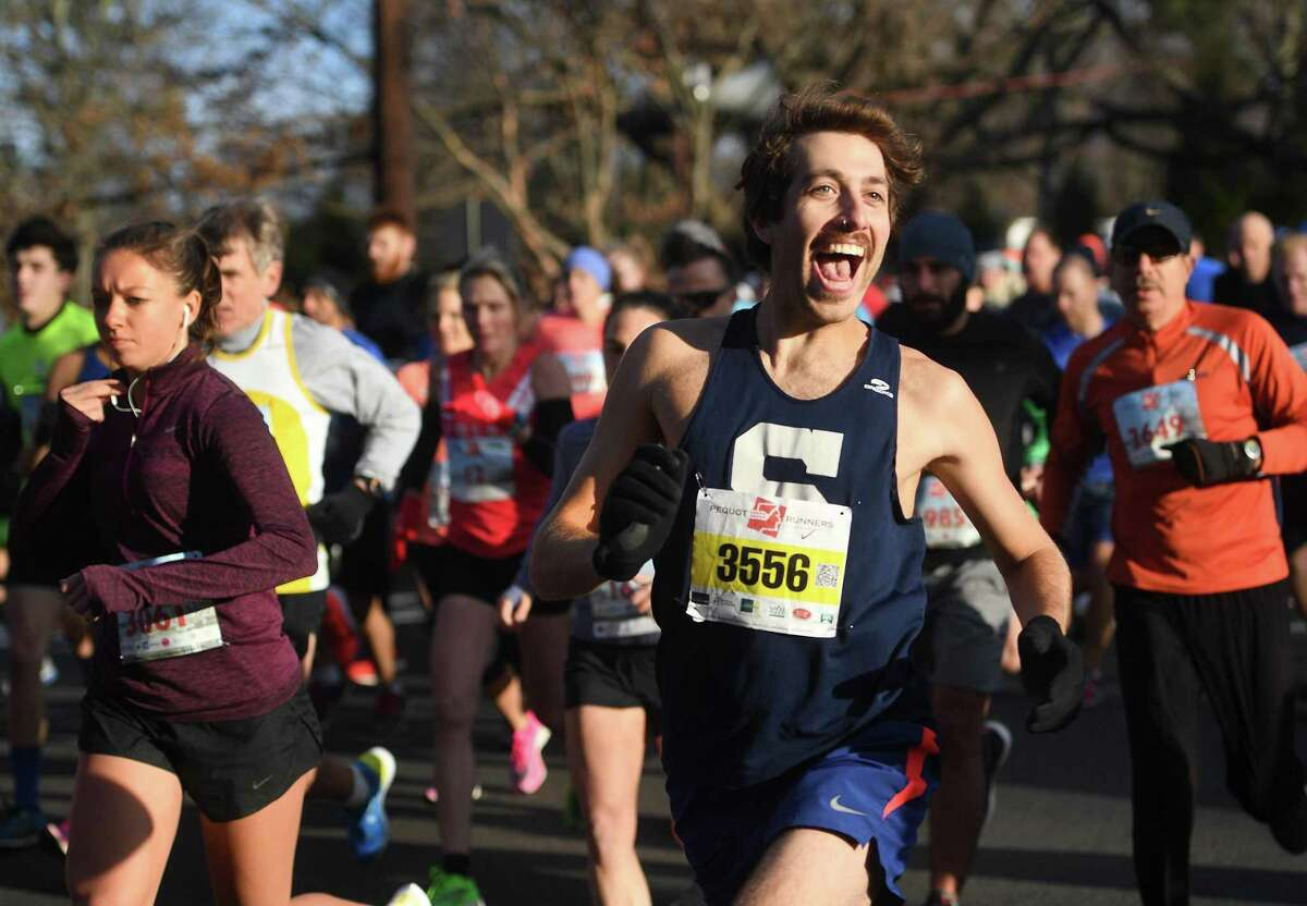 Dave Mortner, of Westport, shouts greetings to a friend as he leaves the start of the 42nd Annual Pequot Runners Thanksgiving Day 5 Mile Road Race, in Southport, Conn. on Thursday, November 28, 2019.