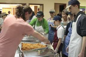 Volunteers came together at Chapel of the Lakes Lutheran Church in Mecosta on Thursday for the annual Community Thanksgiving Dinner. (Pioneer photos/Tim Rath) Volunteers came together at Chapel of the Lakes Lutheran Church in Mecosta on Thursday for the annual Community Thanksgiving Dinner. (Pioneer photos/Tim Rath)