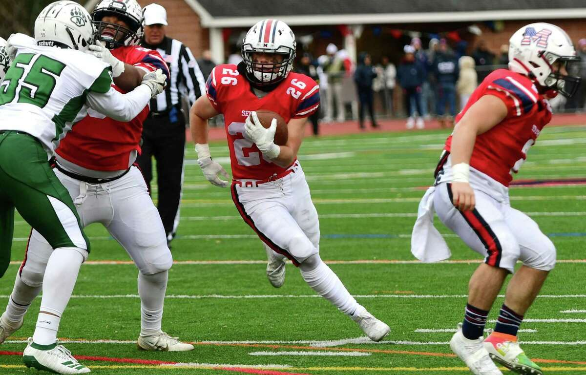 Matt Claps carries the ball for McMahon in theannual Thanksgiving Day intracity football game vs. Noralk on Thursday, November 28, 2019, at Jack Casagrande Fieldin Norwalk, Conn.
