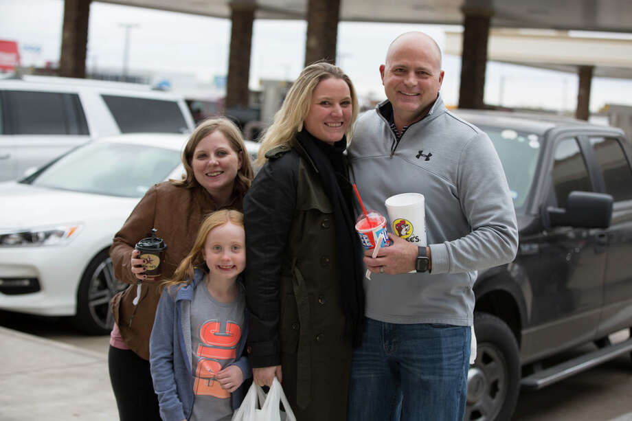 Holiday travelers stop to strike a pose outside the Buc-ee's on Interstate 35 just outside San Antonio on Wednesday, Nov. 27, 2019. They were among the 49.3 million motorists on road this Thanksgiving holiday, according to AAA. Photo: B. Kay Richter, For MySA