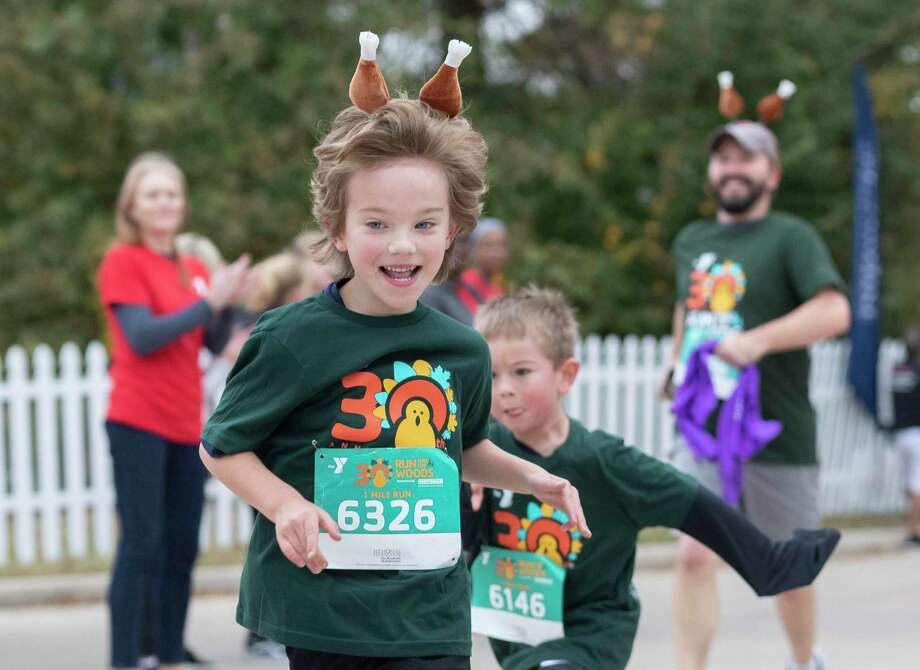 More than 5,200 runners took part in the annual Run Thru the Woods, Thursday, Nov. 28, 2019, in The Woodlands. Photo: Jason Fochtman, Houston Chronicle / Staff Photographer / Houston Chronicle