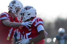 Greenwich's Mason Muir (11) celebrates with AJ Barber (15) after Barber scored on a reception in the first quarter against Staples in their traditional Thanksgiving Day football game at Staples Stadium in Westport, Conn. on Nov. 28, 2019. Greenwich defeated Staples 38-14.
