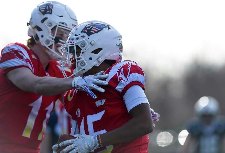Greenwich's Mason Muir (11) celebrates with AJ Barber (15) after Barber scored on a reception in the first quarter against Staples in their traditional Thanksgiving Day football game at Staples Stadium in Westport, Conn. on Nov. 28, 2019. Greenwich defeated Staples 38-14. Photo: Matthew Brown / Hearst Connecticut Media / Stamford Advocate