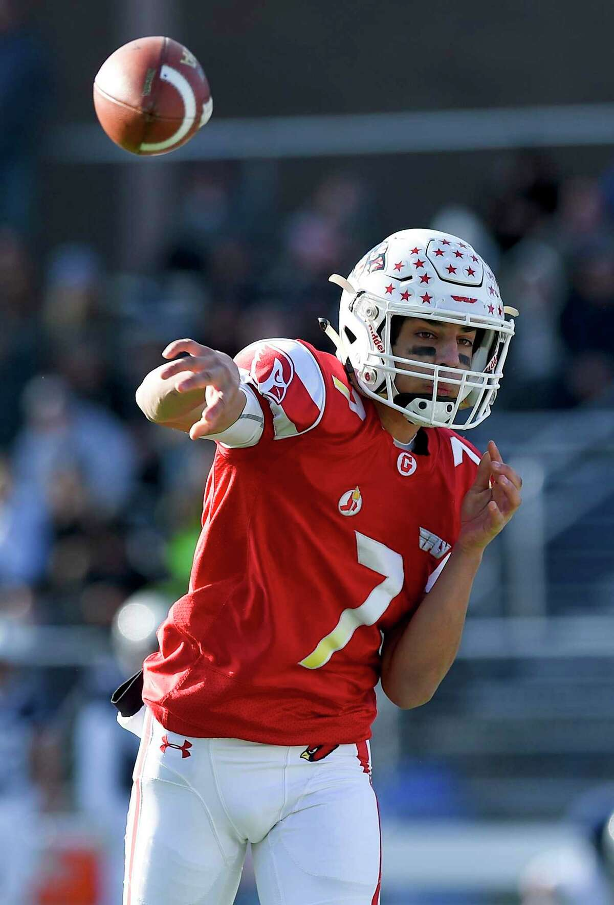 Greenwich quarterback James Rinello (7) throws in the first half against Staples during their traditional Thanksgiving Day football game at Staples Stadium in Westport, Conn. on Nov. 28, 2019. Greenwich defeated Staples 38-14.