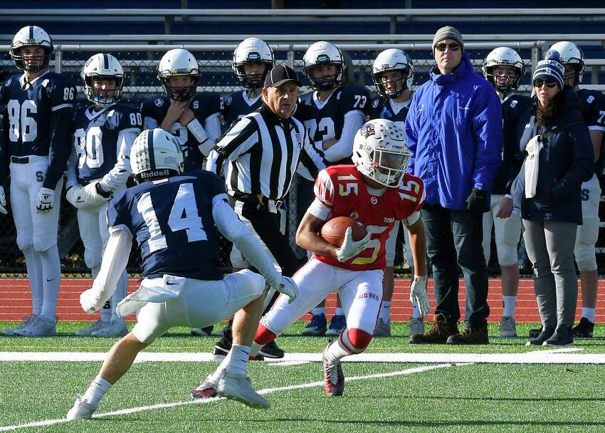 Greenwich's AJ Barber (15) turns on the reception against Staples Ryan Thompson (14) in the first quarter of their traditional Thanksgiving Day football game at Staples Stadium in Westport, Conn. on Nov. 28, 2019. Greenwich defeated Staples 38-14.