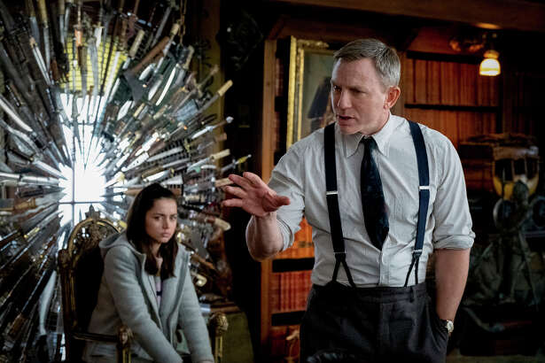 """This image released by Lionsgate shows Ana de Armas, left, and Daniel Craig in a scene from """"Knives Out."""" (Claire Folger/Lionsgate via AP)"""