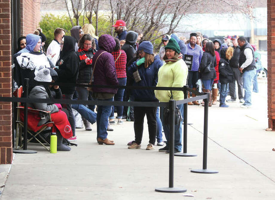 Customers wait in line at about 1 p.m. Thursday for the 2 p.m. opening of the JC Penney store at the Alton Square Mall. The National Retail Federation had projected that almost 40 million Americans would be shopping on Thanksgiving Day.