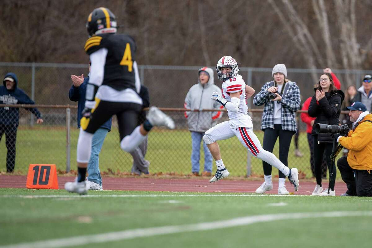 Foran high's Jack Dawid scores the first TD of the game against Jonathan Law on Thanksgiving Day, November 28, 2019