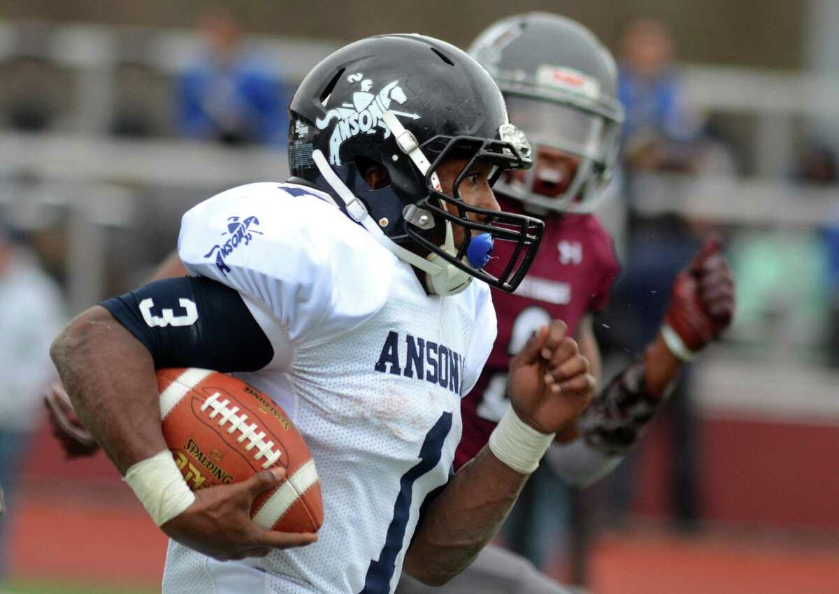 Ansonia's Shaykeem Harmon charges to the endzone to score a touchdown during Thanksgiving Day football action against Naugatuck in Naugatuck, Conn., on Thursday Nov. 28, 2019.